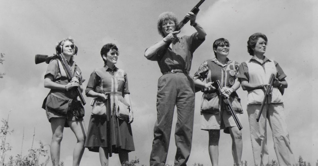 Sue King takes aim as Vicki Ash, Ann Fields, Sandy Brister and Sandi Nail watch closely.